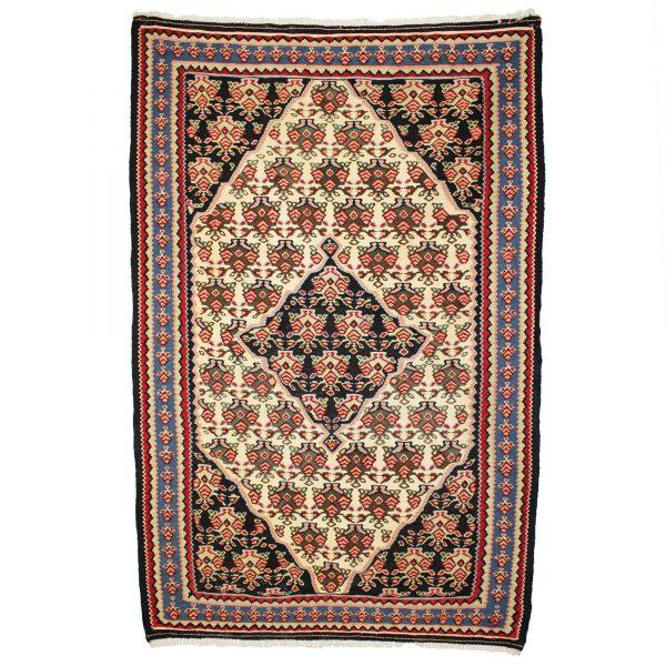 Persian Senneh Kilim Rug with cream background.