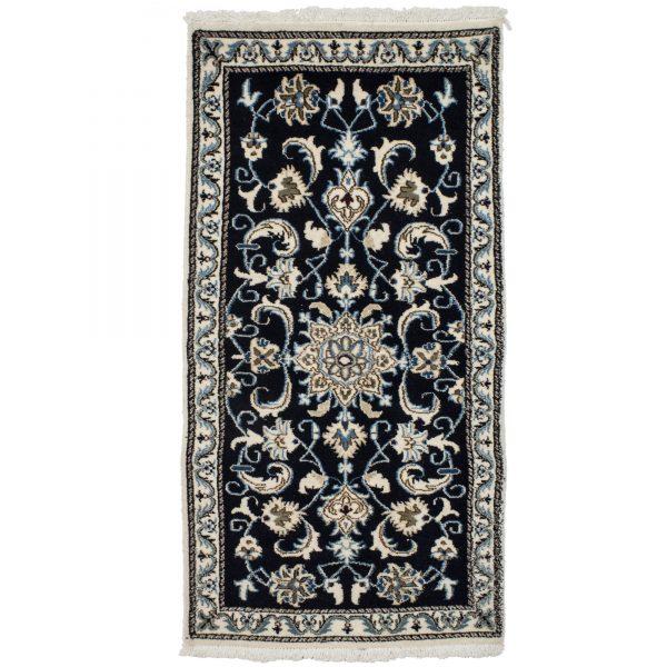 Persian Navy Nain Rug with floral and silk highlights.