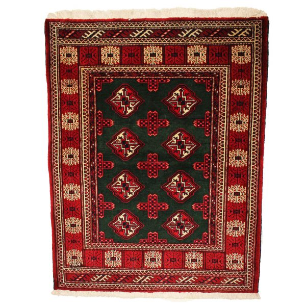Persian Turkoman rug with dark green and red border. wool on wool .