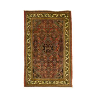 Persian Tajalabad rug with central medallion.