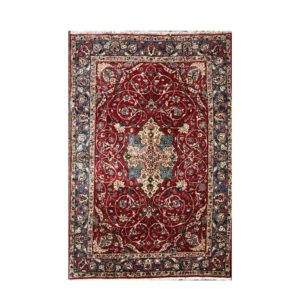 Persian Fine and old Isfahan rug with central floral medallion.